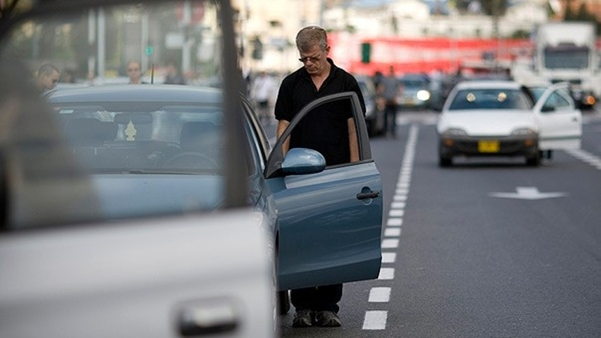 April 12: Israelis stand outside their cars as a siren marking the annual Holocaust remembrance day sounds in Tel Aviv.