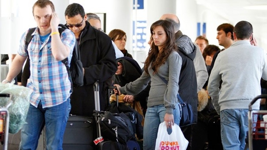 April 18: Passengers wait to check in at British Airways to try and catch flights to Europe at O'Hare International Airport in Chicago.