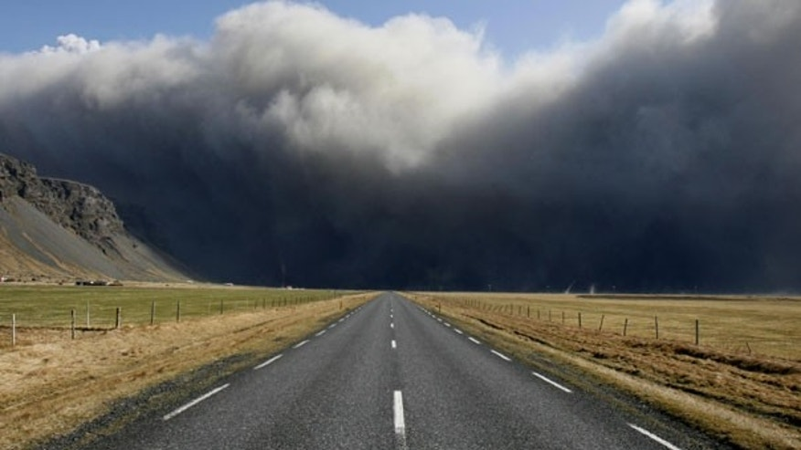 April 17: Volcanic ash is seen over Iceland's main ring road near Skogar, east of the eruption. (AP)
