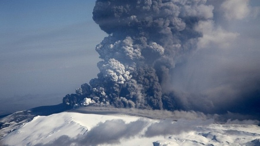 April 17: A cloud of volcanic matter rises from the erupting Eyjafjallajokull volcano in Iceland.