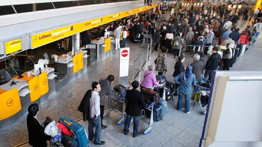 April 20: Passengers line up for departure at Frankfurt airport, central Germany.
