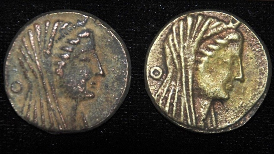 April 22: Some of the 383 recently unearthed bronze coins, said by Egypt's Supreme Council of Antiquities to be inscribed with the hybrid Greek-Egyptian god Amun-Zeus on one side, with an eagle and the words Ptolemy and king in Greek on the other side, dating back to King Ptolemy III who ruled Egypt in the 3rd century B.C. Descendants of one of Alexander the Great's generals, the Ptolemaic dynasty ruled Egypt for some 300 years, fusing Greek and ancient Egyptian cultures.