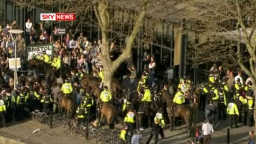 April 22: British police hem in protesters outside the site of a televised debate among British party leaders.