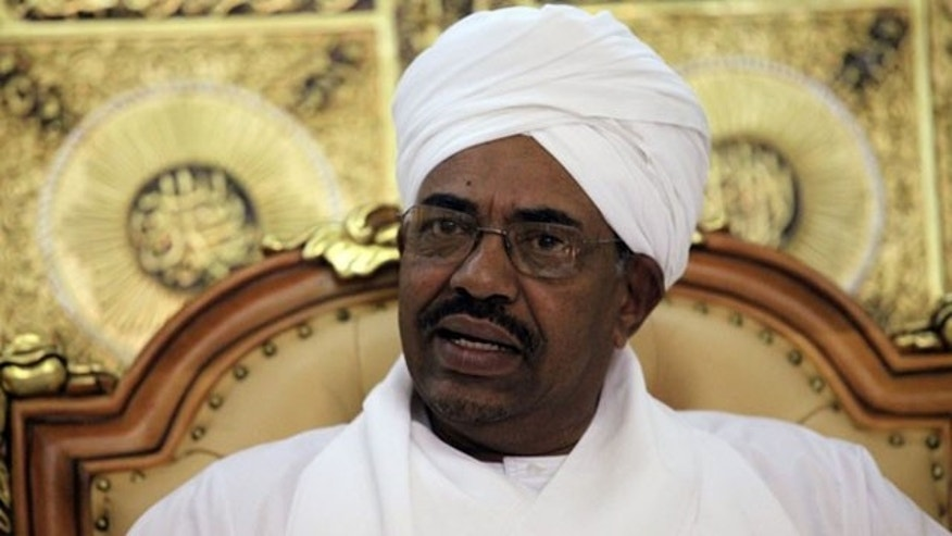 Sudan's President Omar Hassan al-Bashir reacts during a meeting with Haile Menkerios, Special Representative of the U.N. Secretary-General in Sudan, in Khartoum April 20, 2010 (Reuters).