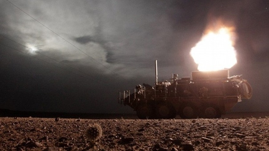 April 27: A U.S. Army Stryker vehicle fires a 120mm mortar during night patrol in Kandahar.