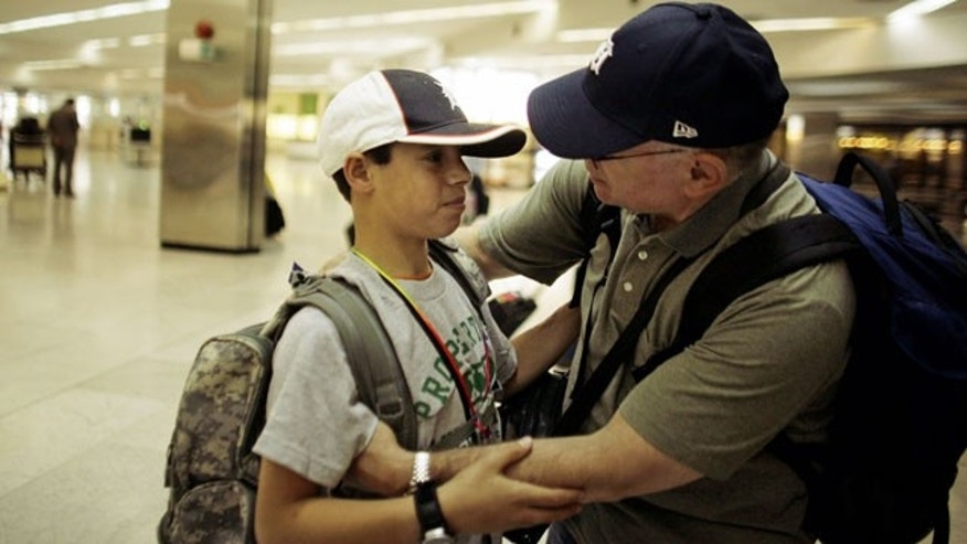 "Mhammed, left, says goodbye to National Guard Maj. David Howell, the man who brought him from Iraq to Michigan to treat his childhood injuries, at Baghdad International Airport, Tuesday, April 27, 2010. Mohammed, whose middle and last names are not being publicized, was brought to the U.S. and treated at the Michigan State University hospital thanks to the efforts of a National Guard major who met him in November 2008 in Ramadi, once an insurgent hotbed west of Baghdad. ""Be brave,"" Howell instructed Mohammed before boarding a return flight."