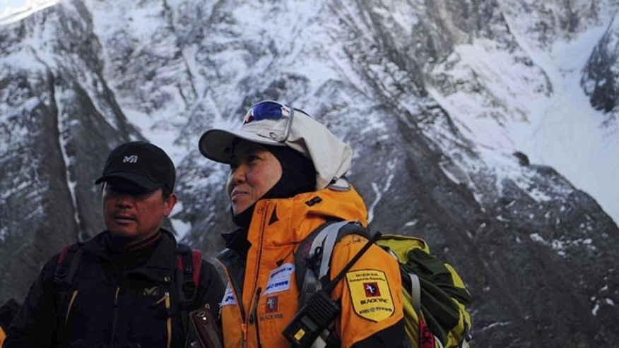 In this Sunday, April 18, 2010 photo released by BLACKYAK, South Korean female climber Oh Eun-son, right, looks on as she moves towards a second camp on Mount Annapurna in Nepal. Oh plans to conquer the 8,000-meter peak of Annapurna. Oh has climbed 13 of the world's highest mountains, with only Annapurna remaining on her list.