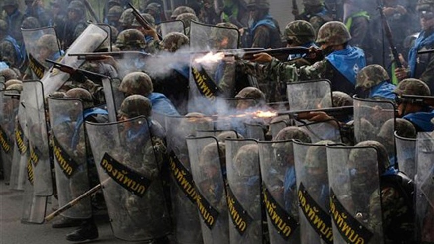 April 28: Thai soldiers fire on anti-government protesters during clashes near Bangkok.