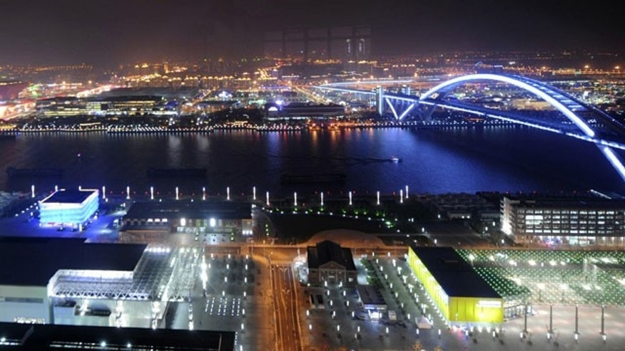 n this photo released by China's Xinhua News Agency, a bridge and both sides of the Huangpu River are illuminated in Shanghai, east China, Friday night, April 30, 2010. The opening ceremony of the 2010 World Expo was held in Shanghai Friday night.
