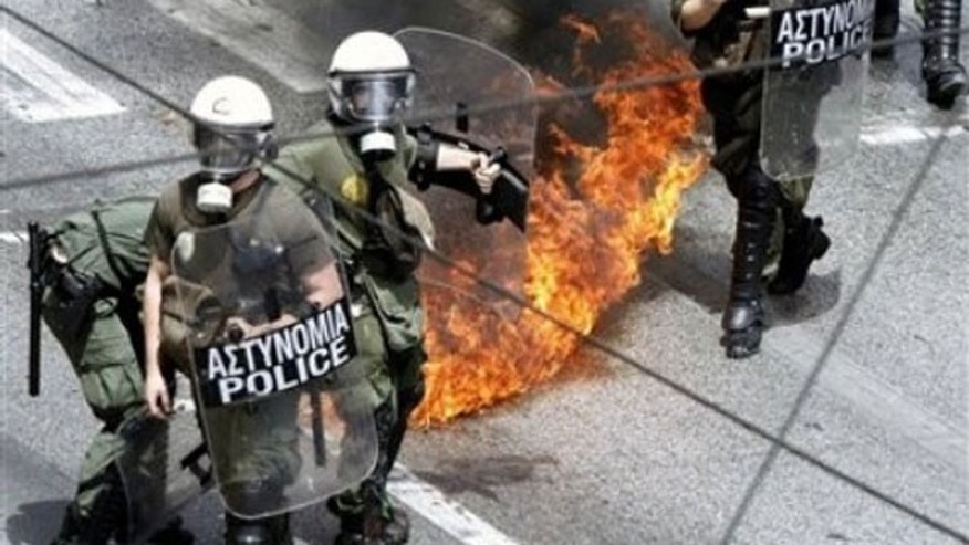 May 5: A petrol bomb expodes near riot police during an anti-government rally in Athens.