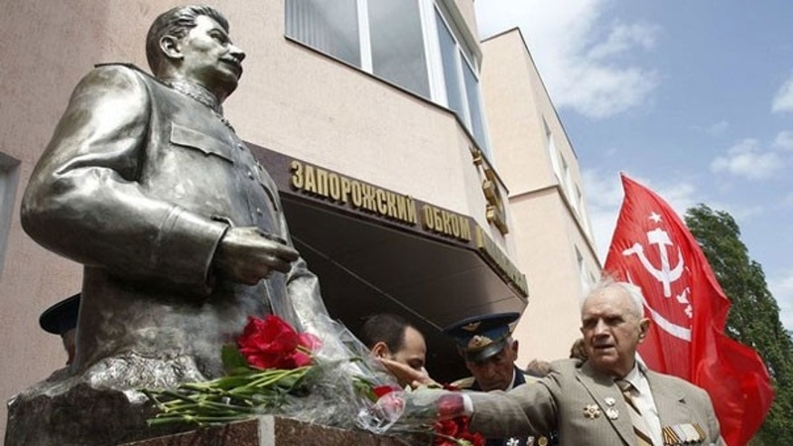 May 5: A World War Two veteran lays flowers at the monument of Soviet dictator Josef Stalin after an unveiling ceremony in the Ukrainian city of Zaporozhye, 300 miles southeast of the capital of Kiev.