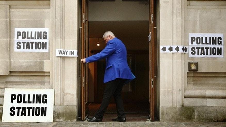 May 6: A staffmember opens the doors of a polling station at the Methodist Central Hall, in the Westminster area of London.