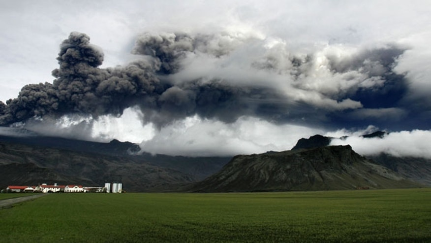 May 5: A plume of ash rises from a volcano erupting under the Eyjafjallajokull glacier, near Hvolsvollur, Iceland.