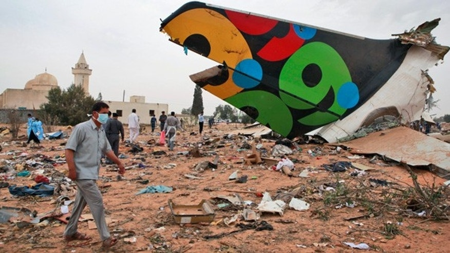 May 12: Rescue teams search the site of the Libyan Afriqiyah Airways plane crash in Tripoli, Libya.