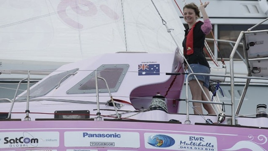 May 15: Sixteen-year-old Jessica Watson waves as she sails past the finish line at the entrance to Sydney Harbour in Sydney, Australia, capping off a nearly 23,000 nautical miles voyage.