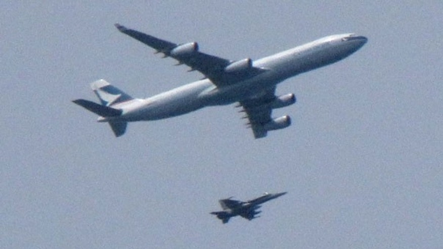 May 15: An F-18 Hornet fighter jet intercepts a Cathay Pacific passenger plane headed for Vancouver, Canada.