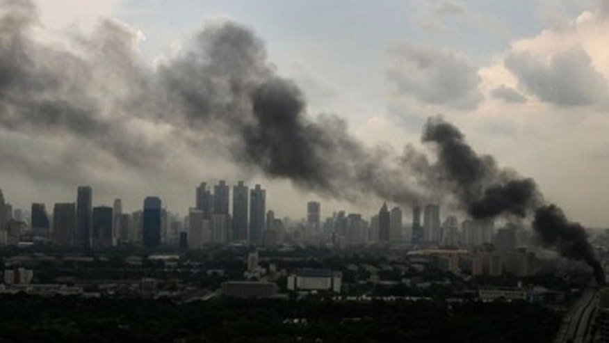 May 16: Heavy smoke appears as anti-government protesters burn tires at a main road in downtown Bangkok, Thailand.