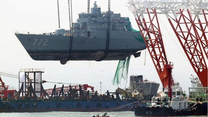 April 24: A giant offshore crane salvages bow section of the sunken South Korean naval ship off Baengnyeong Island, South Korea.