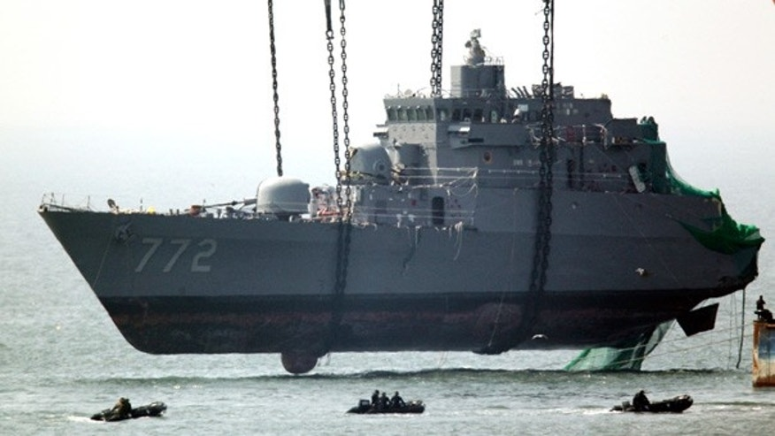 April 24: Sunken South Korean naval ship Cheonan is lifted from waters near the disputed sea border with North Korea.