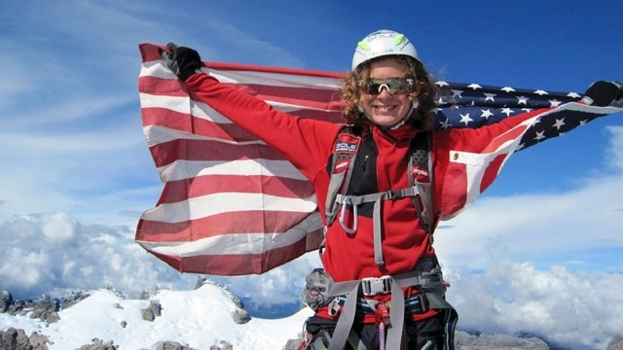 Jordan Romero of California, seen at the Carstensz Pyramid summit in this Sept. 1, 2009, file photo, has become the youngest climber to reach the top of Mount Everest. He is 13 and is one climb away from reaching the highest peaks on all seven continents.