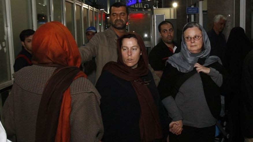 May 21: Nora Shourd, right, mother of Sarah Shourd, Cindy Hickey, center, mother of Shane Bauer, and Laura Fattal, mother of Josh Fattal, back to camera at left, whose children are in jail in Iran, arrive at the Imam Khomeini airport outside Tehran, to leave Iran.