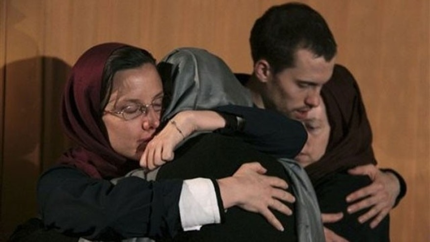May 21: Sarah Shourd, left, hugs her mother Nora Shourd, as Shane Bauer, second right, hugs his mother Cindy Hickey, during their meeting at the Esteghlal hotel in Tehran. The mothers of three Americans jailed in Iran for 10 months had more time with their children on Friday after an emotional reunion a day earlier in a Tehran hotel overlooking Evin prison, where the three have been held since their arrest in July along the Iran-Iraq border (AP).