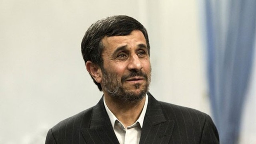 May 18: Iran's President Mahmoud Ahmadinejad looks on as he attends an official meeting in Tehran (Reuters).