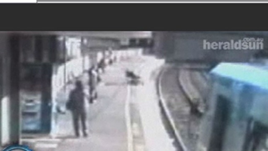 Baby in Australia survives after stroller rolls off platform in front of oncoming train.