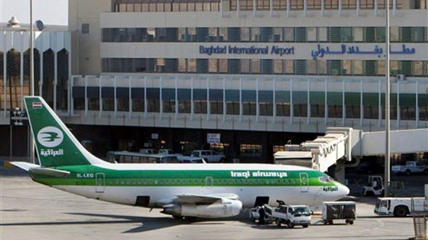 File: an Iraqi airways plane sits on the tarmac at Baghdad International Airport.