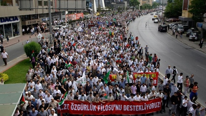 Protesters hold a banner that reads ''We support the fleet of freedom'' during a rally from the Israeli Consulate to Taksim square in Istanbul, Monday, May 31, 2010. About 10,000 people gathered in the Turkish capital to protest Israel's military assault on a convoy of six humanitarian aid ships traveling to Gaza. Israeli naval commandos stormed a flotilla of ships in Mediterranean international waters, carrying aid and pro-Palestinian activists towards the blockaded Gaza Strip on Monday, killing at least 10 passengers in the predawn raid.