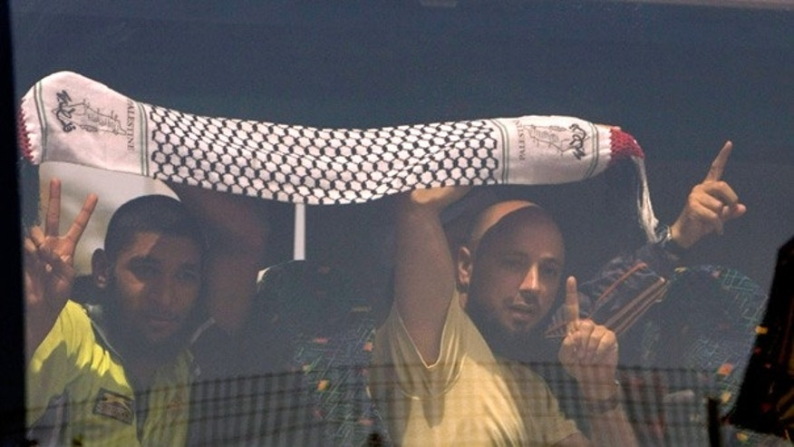 June 2: Detained activists from the Gaza-bound flotilla flash victory signs as their bus arrives at Ben Gurion airport near Tel Aviv.