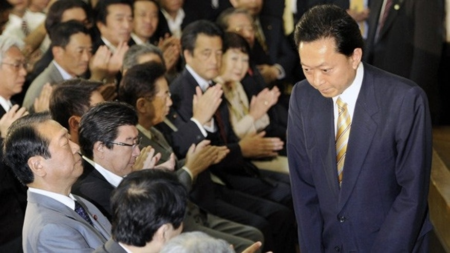 June 2: Japan's Prime Minister Yukio Hatoyama bows after announcing his resignation in Tokyo.