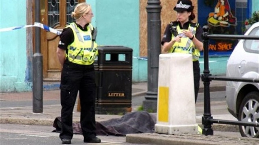 "June 2: Police stand next to a body following a shooting on Duke Street, in the town of Whitehaven in northwest England. British police were hunting down a man suspected in a shooting spree that has left more than one person dead in northwest England. The Cumbria Constabulary said there have been ""a number of fatalities"" as well as several injuries after shots were fired in the town of Whitehaven and nearby Seascale and Egremont (AP)."