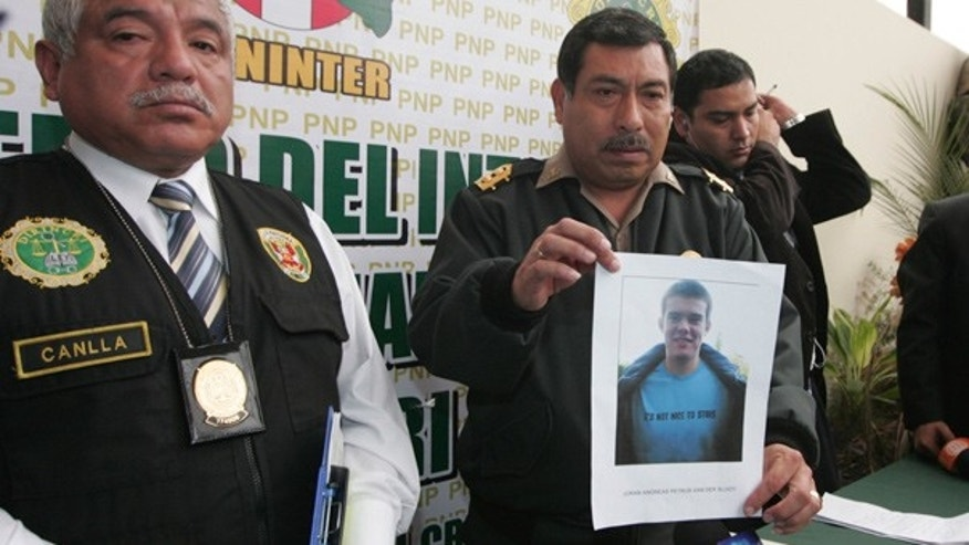 June 2: Police show a photo of Dutch citizen Joran van der Sloot at a news conference in Lima.