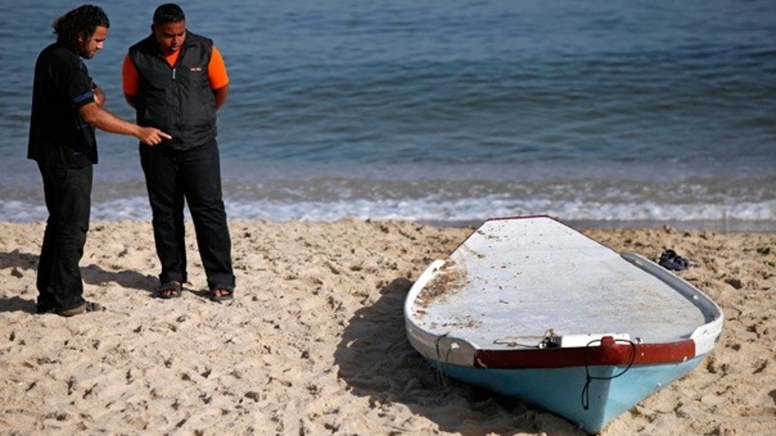 June 7: Palestinians look at a boat used by Palestinian militants after they were killed by Israeli forces off the coast of Gaza.