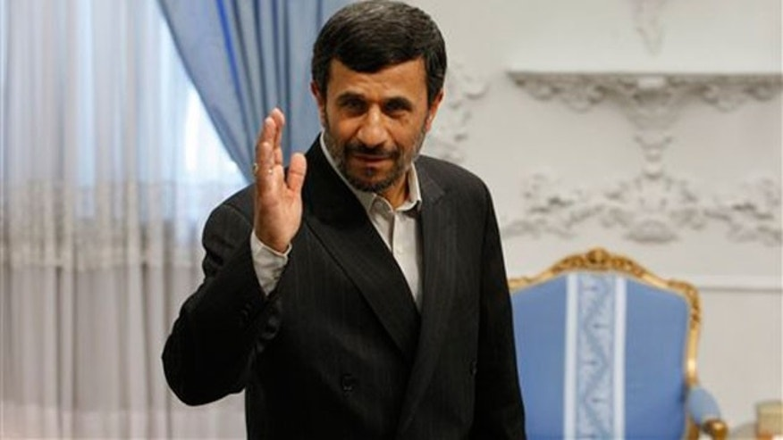 File: Iranian President Mahmoud Ahmadinejad, waves to the media, prior to a meeting at the presidency in Tehran, Iran.
