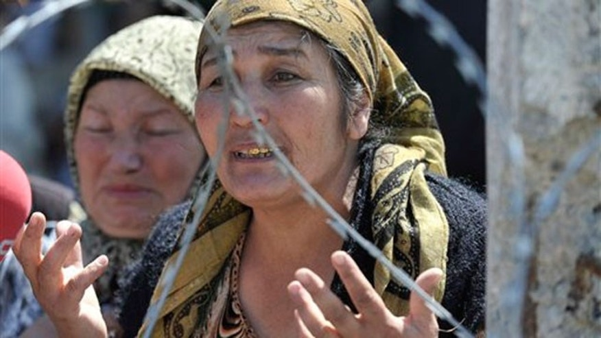 June 14: Some 100,000 minority Uzbeks fleeing a purge by mobs of Kyrgyz gather at the border, as the deadliest ethnic violence to hit this Central Asian nation in decades left a major city smoldering.
