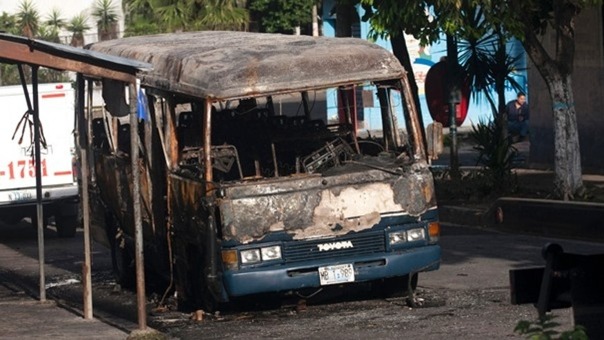 June 21: The bus was attacked Sunday night while driving along its regular route in the northern area of San Salvador, killing at least 10 people who were aboard and leaving several others badly hurt. (AP)