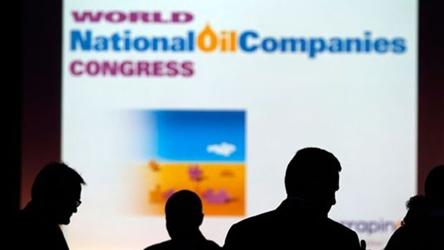 June 22: Delegates are seen during a break of the sessions of the World National Oil Companies Congress, in London.