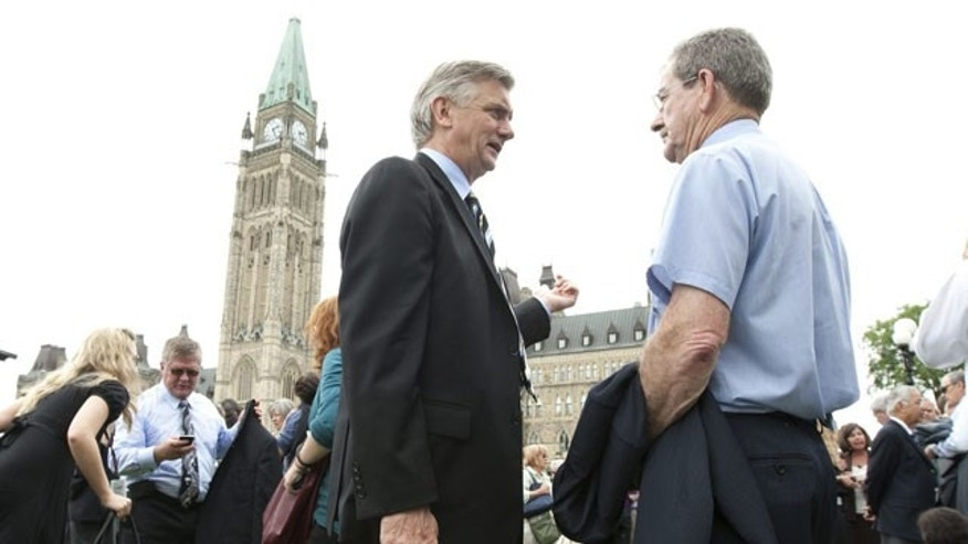 June 23: Senators, parliamentarians and their staff are shown after being evacuated from Parliament Buildings following an earthquake in Ottawa, Canada.