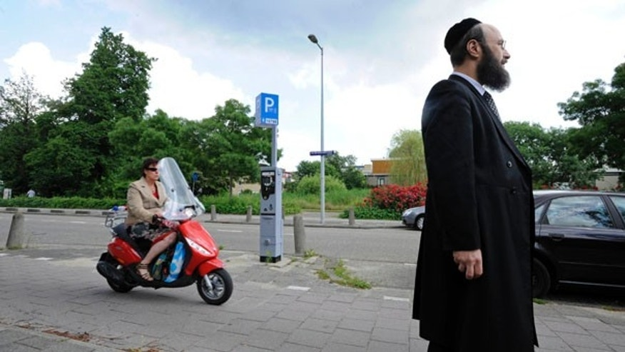 June 25: Rabbi Eliezer Wolff is seen in Amsterdam, Netherlands. A secret video showing Jews harassed on the street in Amsterdam have prompted Dutch authorities to consider using 'decoy Jews,' undercover officers wearing yarmulkes, to combat hate crimes.