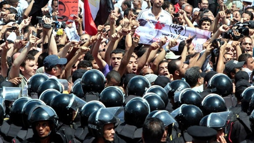June 25: Hundreds of angry demonstrators shout anti-police slogans during a protest in Alexandria, Egypt. Protesters rallied after a 28-year-old businessman was allegedly beaten to death by police on an Alexandria street.