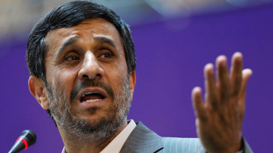 June 20: Iranian President Mahmoud Ahmadinejad gestures while speaking in the International Conference of Islamic World Publishers in Tehran.
