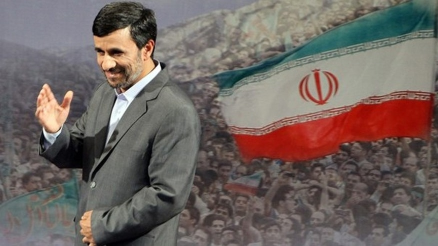 June 28: Iranian President Mahmoud Ahmadinejad gestures after speaking to the press in Tehran.