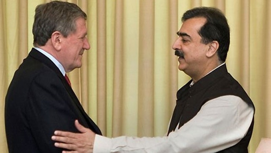 June 19: U.S. envoy to Afghanistan and Pakistan Richard Holbrooke, left, is welcomed by Pakistani Prime Minister Yousuf Raza Gilani prior to their meeting in Islamabad, Pakistan.