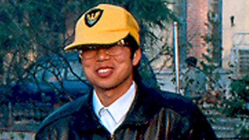 In this file photo released by David Rowley, taken Dec. 7, 1993 and made available Thursday, Nov. 19, 2009, Xue Feng poses for photos in Yuexi, Anhui province.