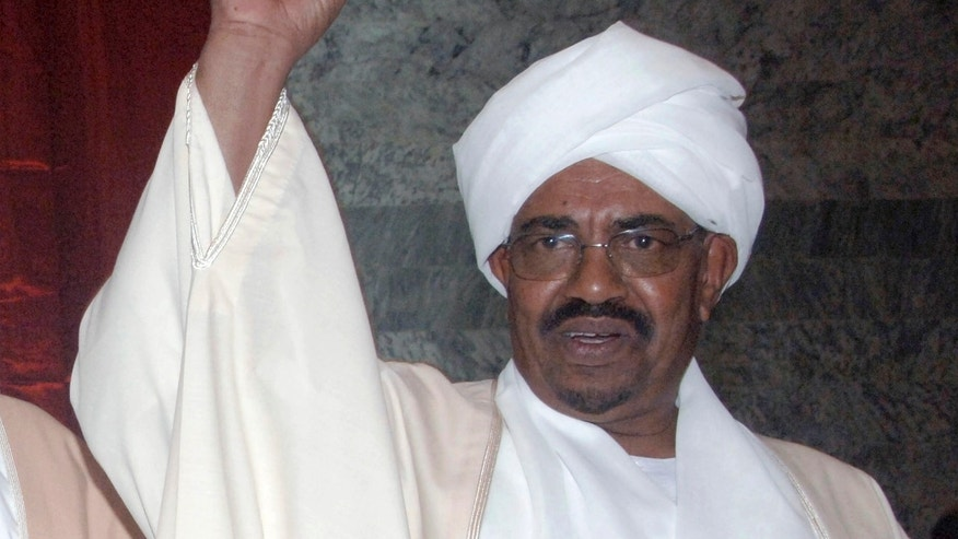 May 27: Sudan's president Omar al-Bashir gestures prior to being sworn in, at the parliament in Khartoum, Sudan. (AP)
