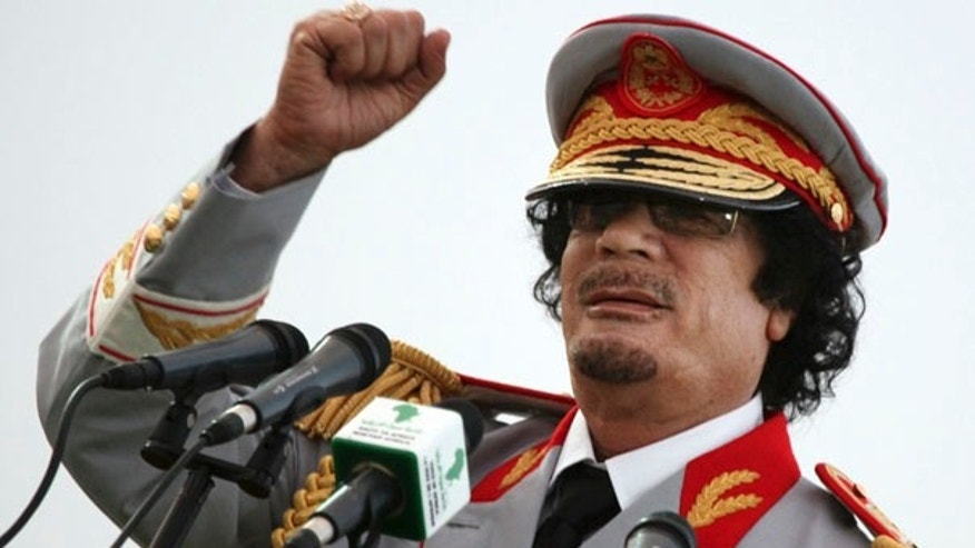 June 12: Libyan leader Muammar Qaddafi speaks during a ceremony in Tripoli.