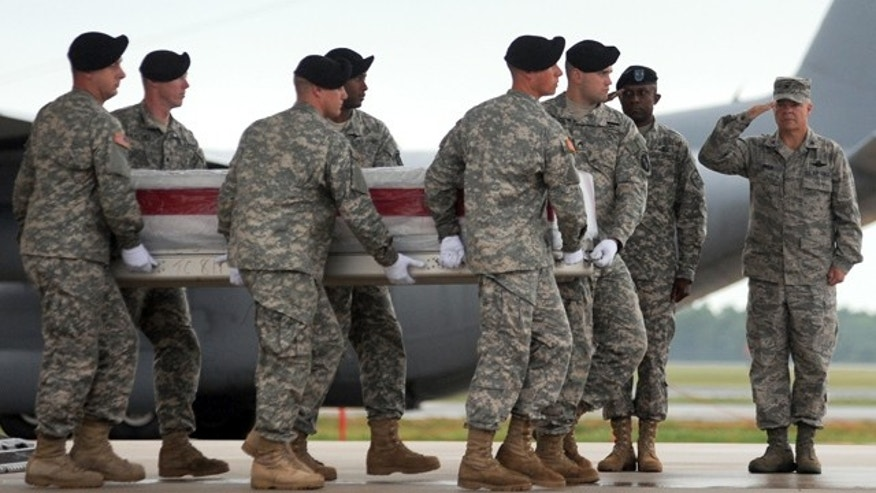 An Army carry team carries a transfer case containing the remains of Pfc. Nathaniel D. Garvin Wednesday, July 14, 2010 a Dover Air Force Base, Del. According to the Department of Defense, Garvin, 20, of Radcliff, Ky., died July 12 at Forward Operating Base Frontenac, Kandahar, Afghanistan of injuries sustained from a non-combat related incident. (AP Photo/Steve Ruark)