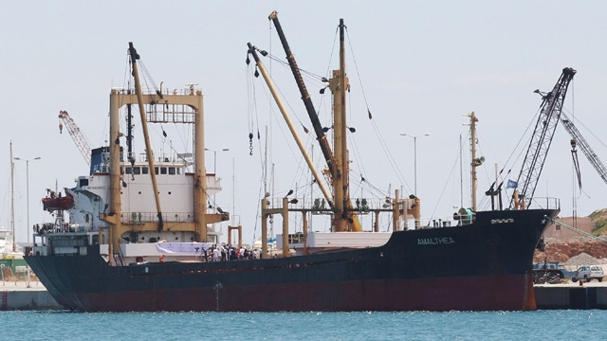 July 9: The cargo ship Al Amal, chartered by a Libyan charity run by Muammar al-Qaddafi's son to break Israel's naval blockade of Gaza and deliver about 2,000 tons of aid, is seen loading up in a Greek port.